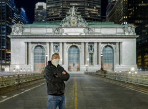 Giles Ashford stands in front of Grand Central Terminal at night