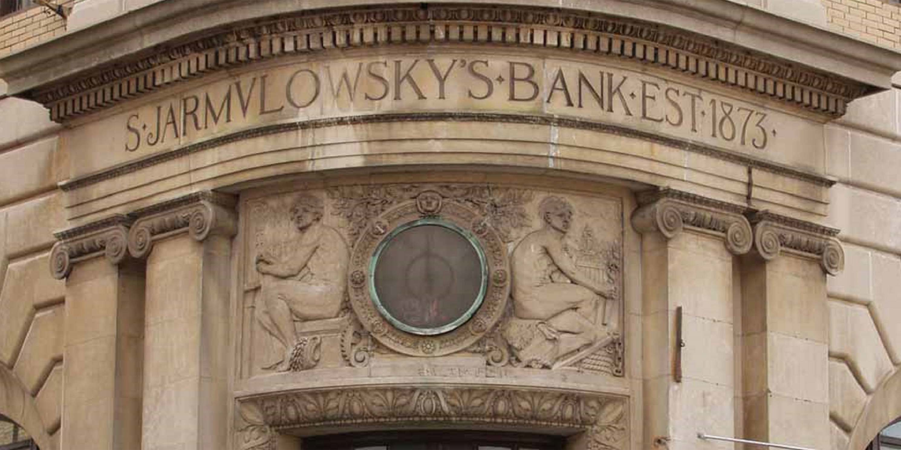 sign for Jarmulowsky Bank carved into stone facade of building