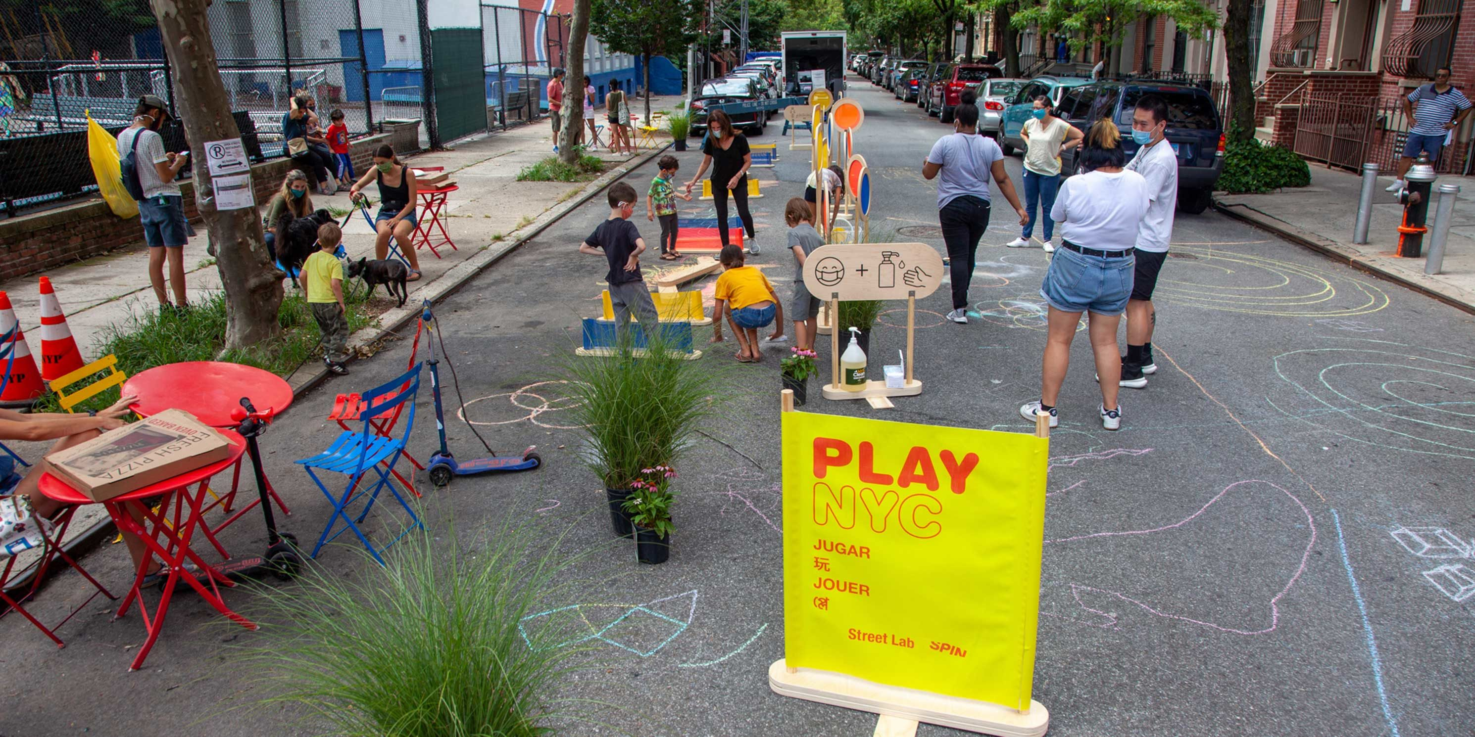 children play on 101st Street in East Harlem during an Open Streets event
