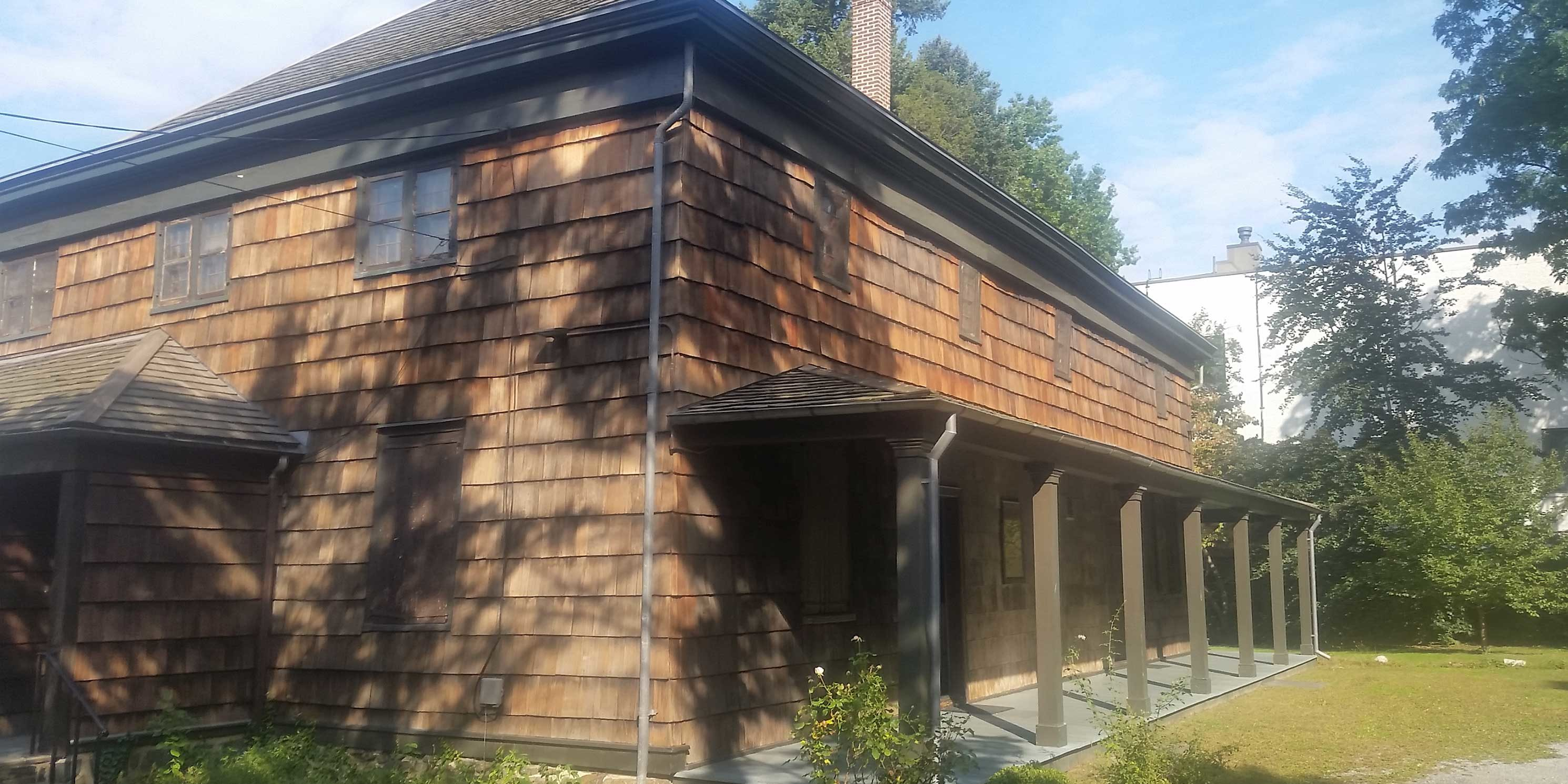 exterior of the wooden Quaker Meeting House in Queens, New York