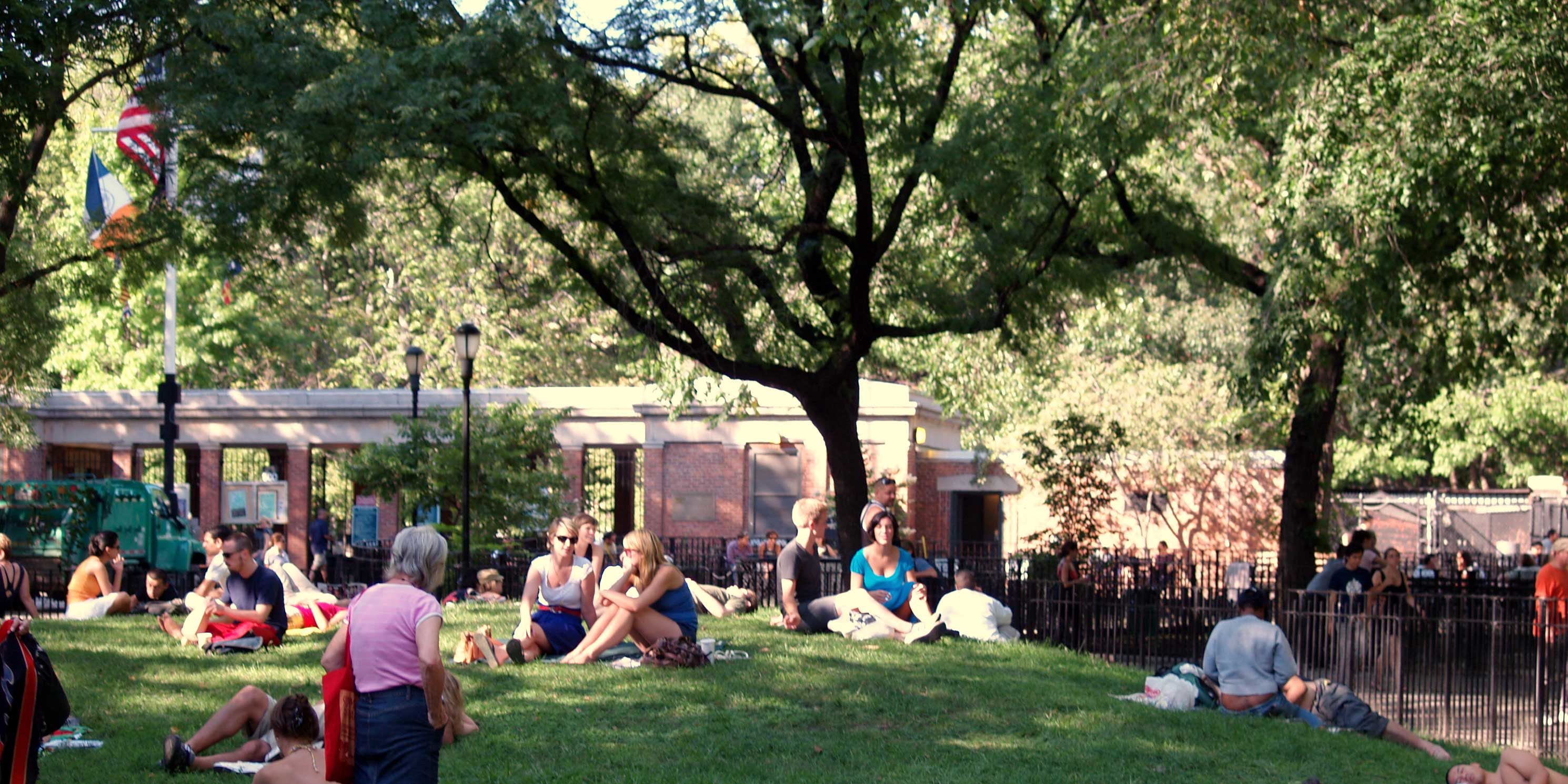 sunbathers in Tompkins Square Park