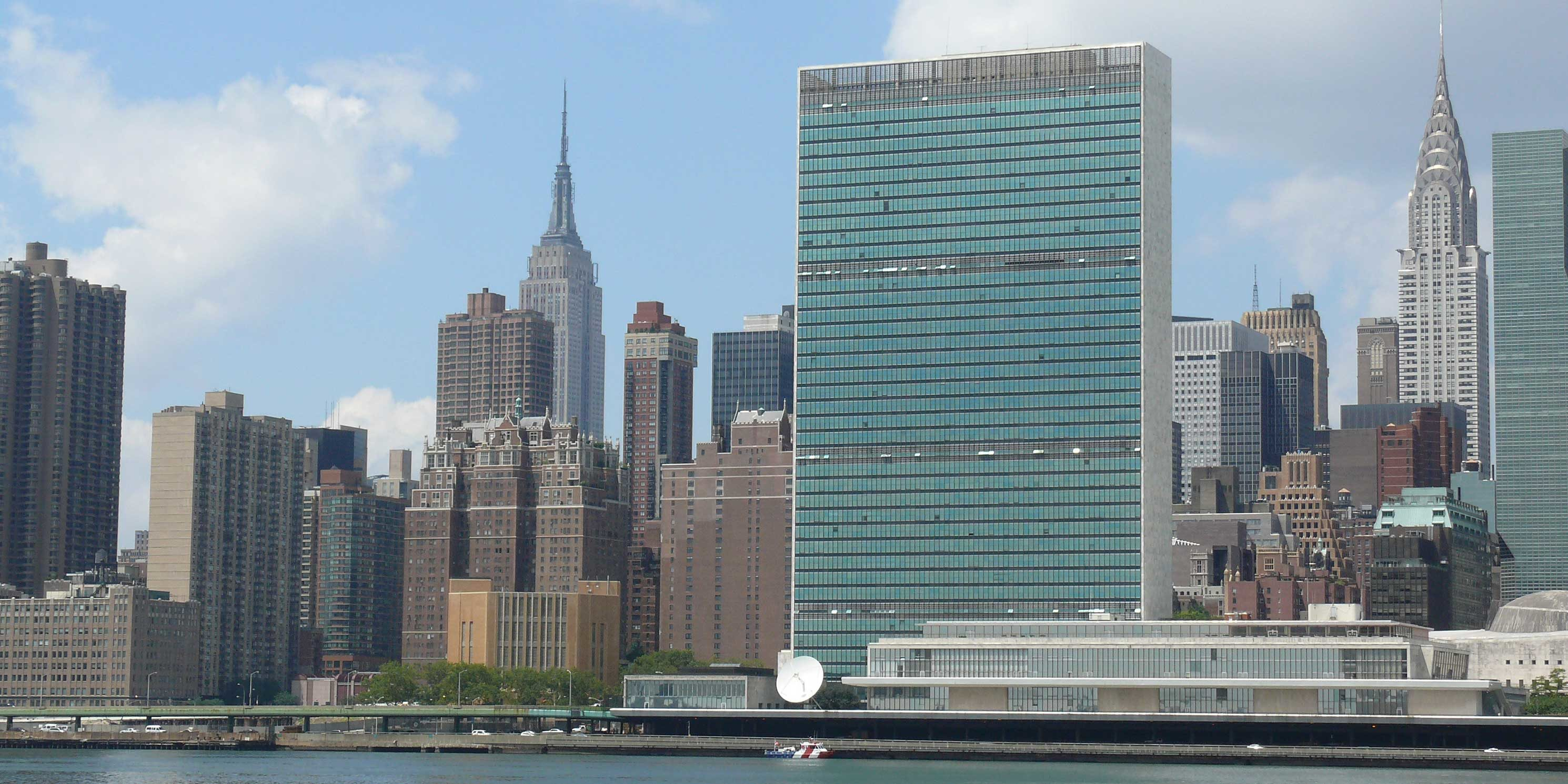 view of Manhattan with the United Nations, Empire, and Chrysler buildings in view