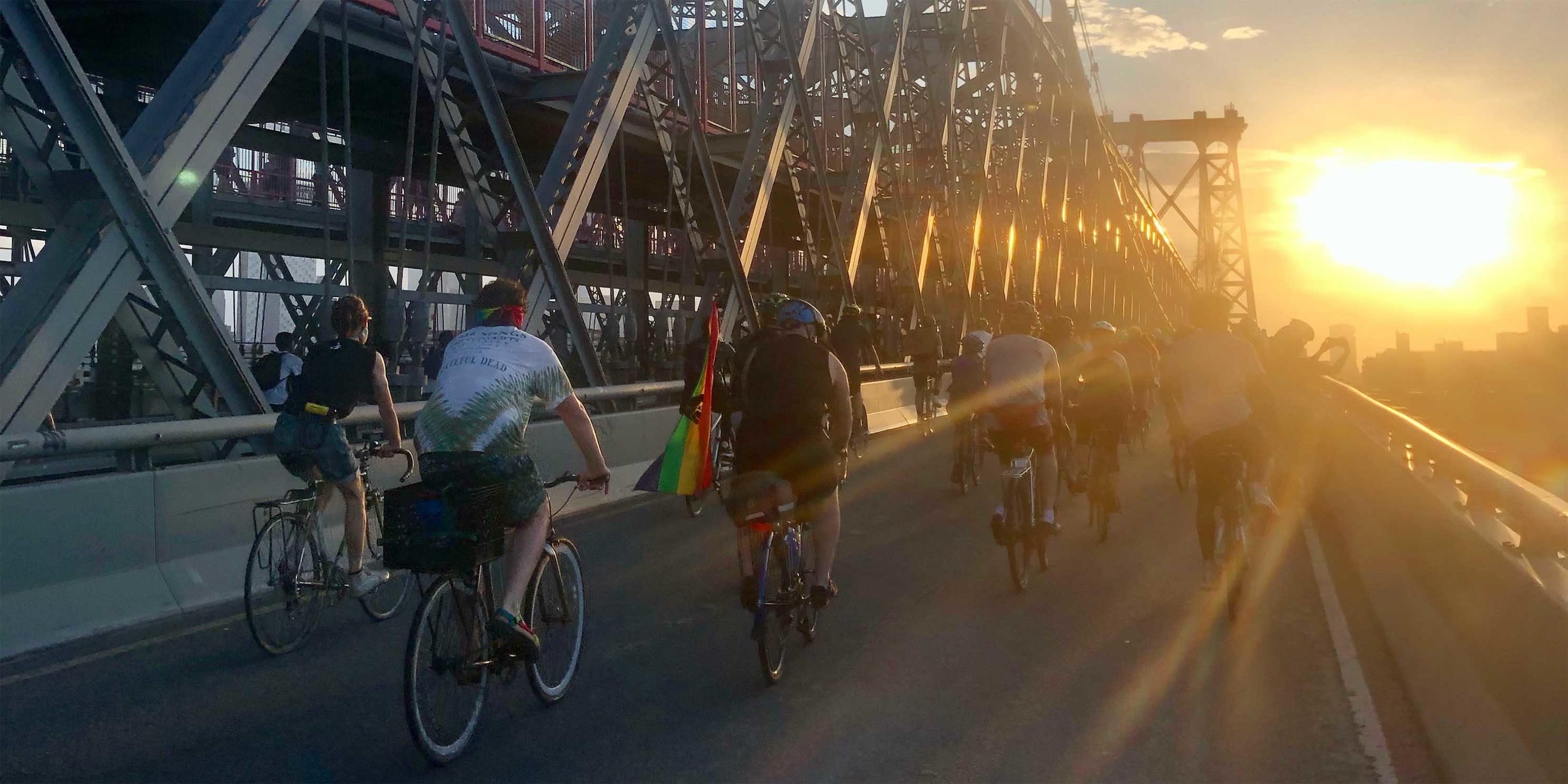 bicyclists ride across bridge in New York City