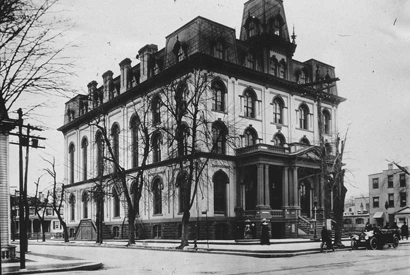 a large building and street in Jamaica, New York circa early 1900s