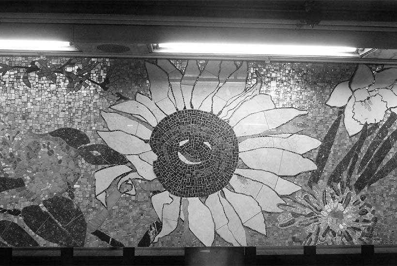 mural of a flower at the 77th Street Station in Manhattan